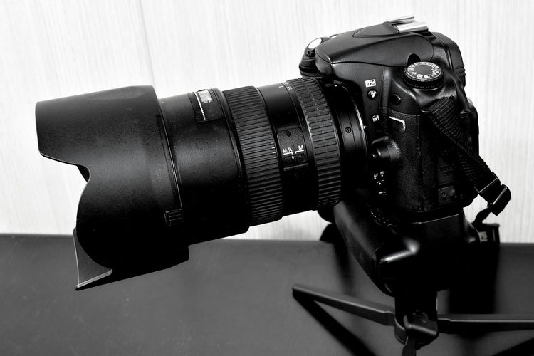 DSLR camera with zoom lens and lens shade on small table tripod DSLR DX Camera FX Website Design Camera - Photographic Equipment Close-up Day Digital Camera Digital Single-lens Reflex Camera Dslr Camera Dx Equipment Film Industry Full Frame Indoors  Lens Shade No People On Tripod Photo Camera Photography Themes Table Tripod Technology Zoom Lens