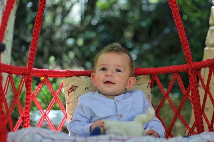 Portrait of cute babyboy sitting on playground