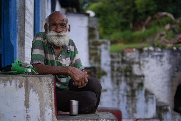 Portrait of senior man sitting outdoors