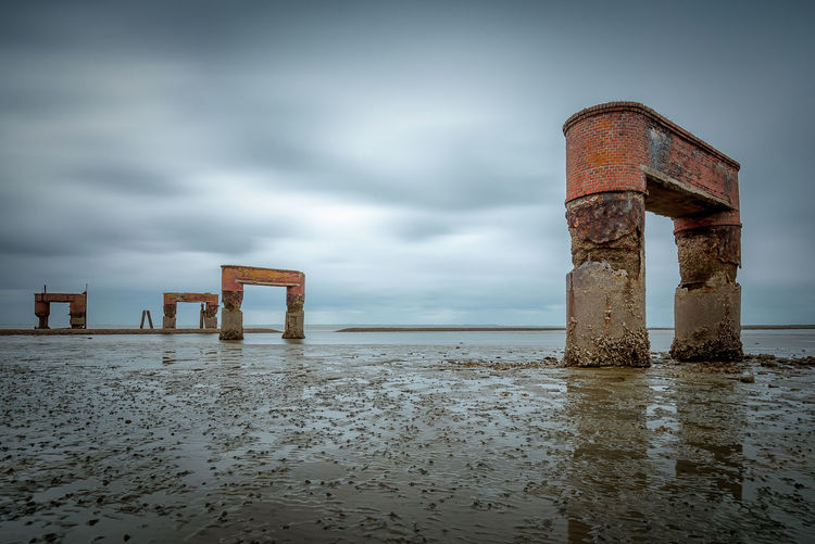 Expired Ferry boat terminal in Eckwarderhörne Water Sky Land Beach Sea Nature Abandoned Cloud - Sky No People Horizon Tranquil Scene Tranquility Horizon Over Water Rusty Overcast Wet Damaged Outdoors Post Deterioration Wooden Post Ruin Ferryboat EyeEmNewHere Muddy