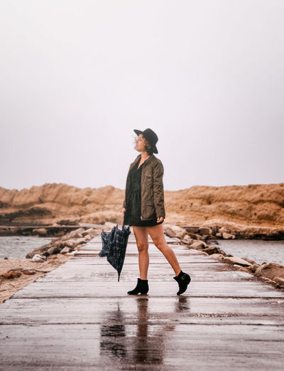 Autumn Fall Beauty Rainy Days Woman Adult Adults Only Casual Clothing Clear Sky Day Fall Fall Day Full Length Lifestyles Nature One Person Outdoors People Real People Rear View Sky Walking Water Women Young Adult Young Women Fresh On Market 2017