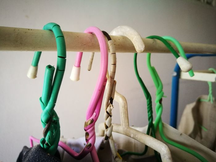 Close-up of multi colored hanging on clothesline