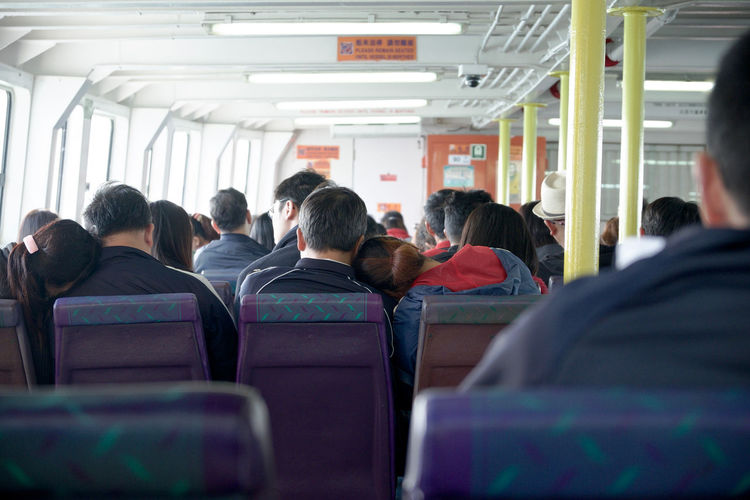 Couples resting on each other as they travel from Hong Kong to Cheung Chau. Cheung Chau China Couple Depth Of Field Ferry Hong Kong Indoors  Love Moments Real People Selective Focus Togetherness Transportation Travel Fujifilm On The Way Connected By Travel