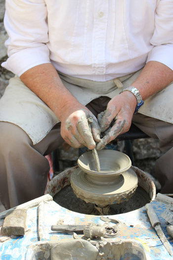 Art And Craft Clay Craft Creativity Day Expertise Hand Human Hand Making Men Midsection Molding A Shape Mud Occupation One Person Outdoors Pottery Preparation  Real People Skill  Working Workshop EyeEmNewHere