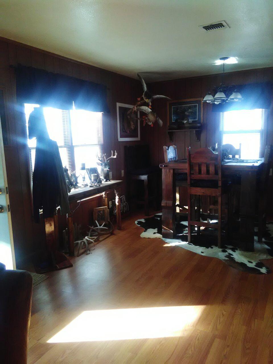 indoors, chair, hardwood floor, illuminated, home interior, no people, day, home showcase interior