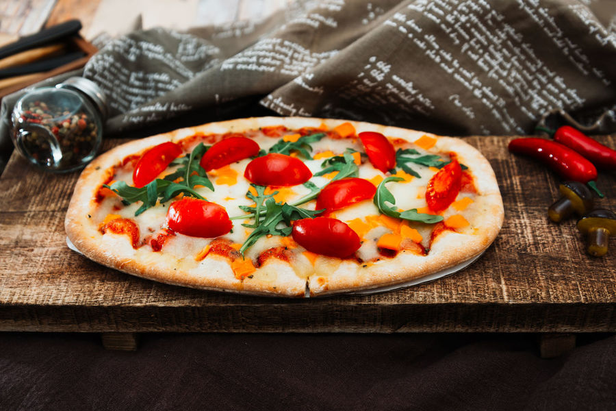 Food Food And Drink Pizza Tomato Dairy Product Vegetable Cheese Wood - Material Italian Food Freshness Unhealthy Eating Herb Table Indoors  No People Fruit Mozzarella Fast Food Close-up Meal Savory Sauce Snack