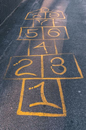 High angle view of hopscotch drawing on road