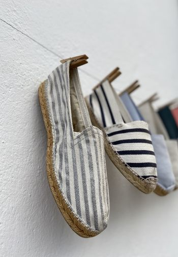 Close-up of shoes hanging against wall