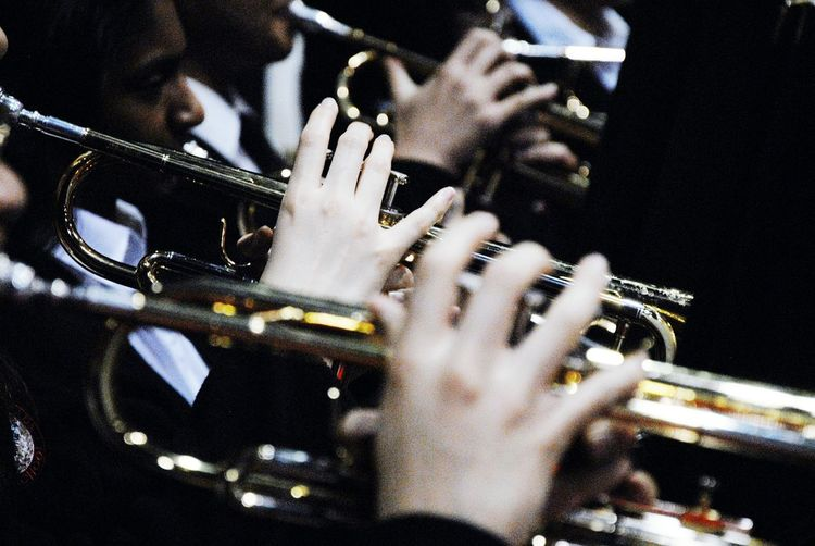 Cropped Image Of Musician Playing Trumpets