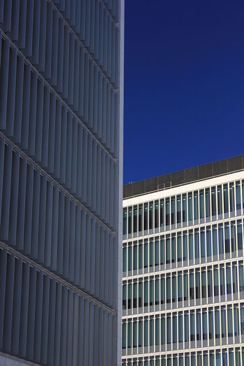 Architecture Blue Building Exterior Built Structure City Clear Sky Day Low Angle View Modern No People Office Block Office Building Exterior Outdoors Sky Skyscraper Window