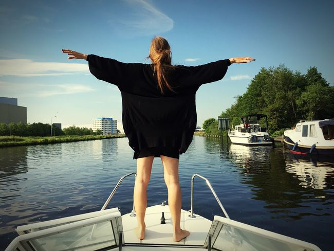 Water Sky One Person Transportation Human Arm Real People #FREIHEITBERLIN Nautical Vessel Leisure Activity Nature Lifestyles Day Arms Outstretched Rear View Standing Mode Of Transportation