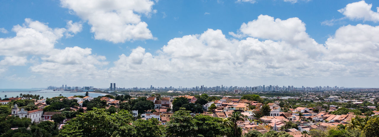 Panoramic View Of Town Against Sky