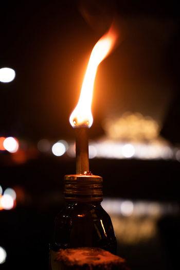 Close-Up Of Oil Lamp In Dark At Night