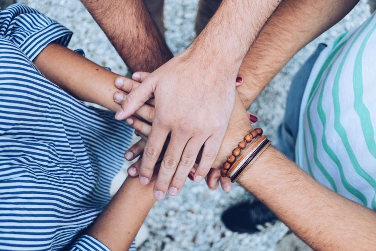 Directly above shot of male friends stacking hands