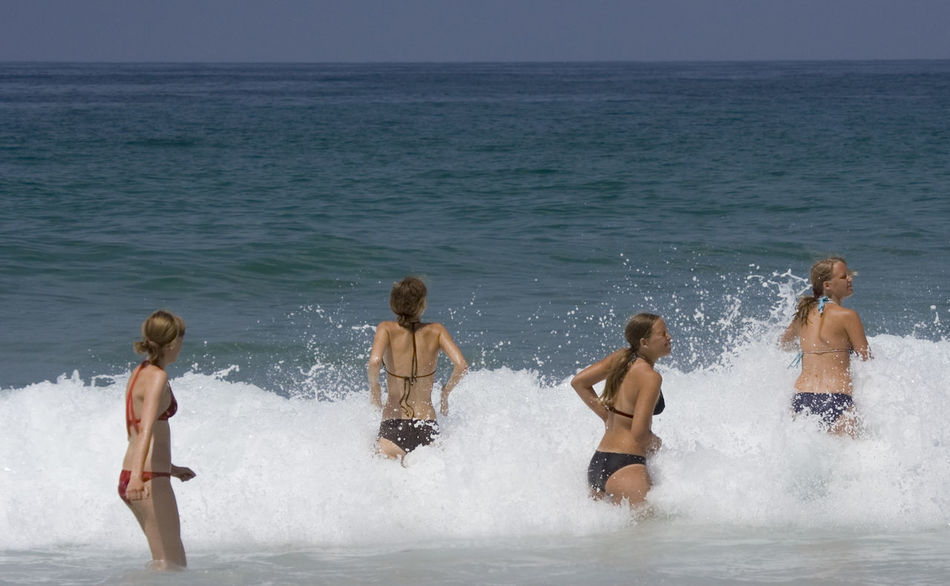 four girls in the high waves of the atlantic ocean - cote d'argent, france Aquitaine Atlantic Ocean Beach Beach Life Big Wave Bikini Cote D'argent Excitement France Fun Girl Girls Happiness Playing Sea Small Group Of People Splashing Summer Swimming Teenage Girls Togetherness Vacations Water Wave Young Women