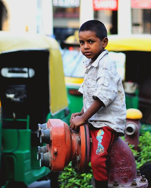 Pipeline Street Streetphotography Child Poverty EyeEm Selects Childhood One Person Child Real People Lifestyles Women Focus On Foreground Day City Innocence First Eyeem Photo This Is Strength