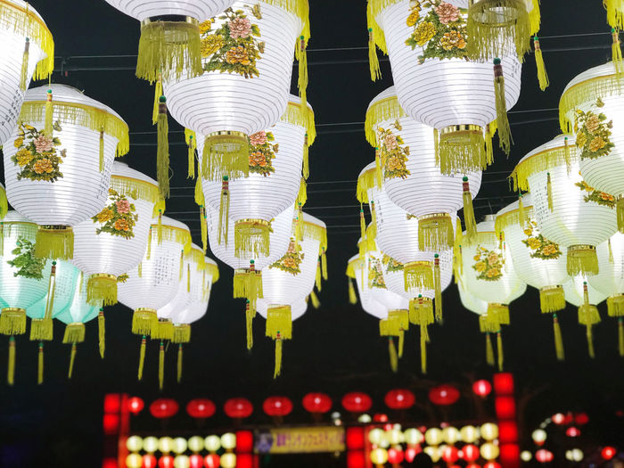 Low angle view of illuminated lanterns hanging