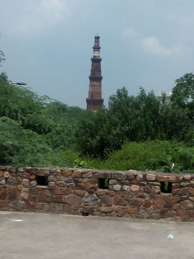 Built Structure Architecture History Building Exterior Tower Old Ruin Brick Wall Outdoors Cloud - Sky Roof No People Day Tree Sky Travel Destinations Lookout Tower Clock Tower Water City Nature Qutub Minar, New Delhi Sky Spanish Culture Stone Material Tall Tall - High Tourism Tower EyEmselect EyEmNewHere