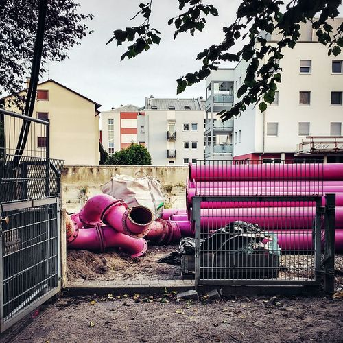 Pink Metallic Pipes At Construction Site In City