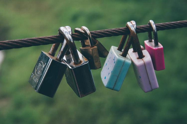 Close-up of padlocks on rope