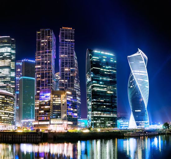 Building Exterior Architecture Built Structure Illuminated City Night Building Financial District  Residential District Waterfront Landscape Cityscape Tall - High No People Office Building Exterior Skyscraper Modern Water Office Sky