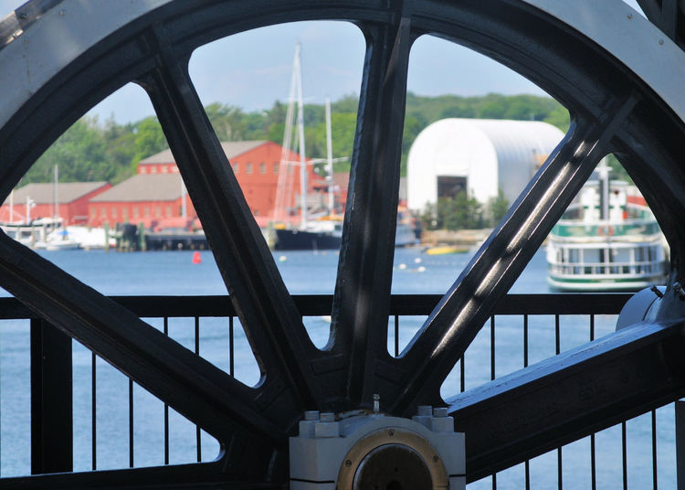 A different view of Mystic, Connecticut Connecticut New England  Architecture Bridge - Man Made Structure Built Structure Close-up Coastal Town Contrast Day Different View Focus On Foreground Gears Looking Through Nautical Vessel No People Ocean Outdoors Railing Spokes Transportation Unique Perspective