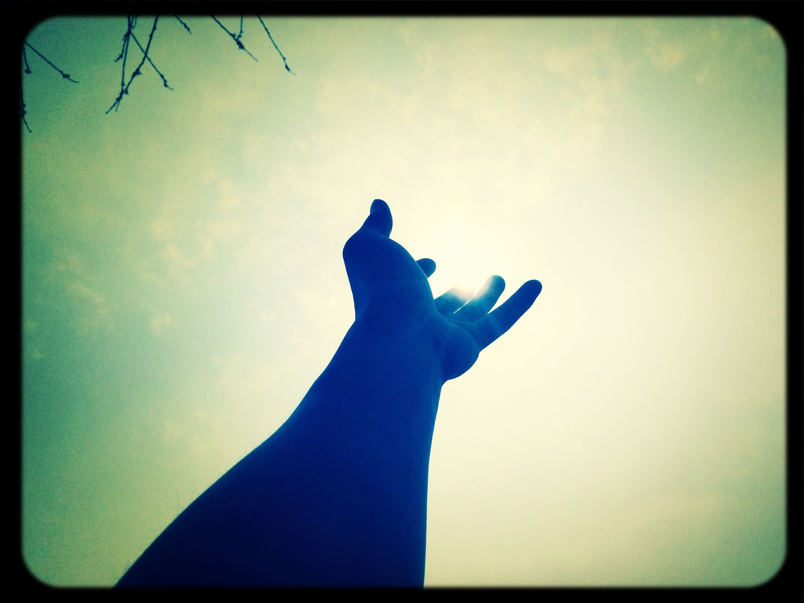 transfer print, auto post production filter, sky, lifestyles, leisure activity, person, low angle view, blue, cloud - sky, holding, men, silhouette, part of, unrecognizable person, human finger, personal perspective