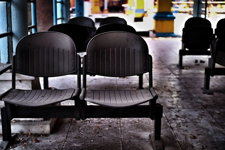 Empty chairs in city