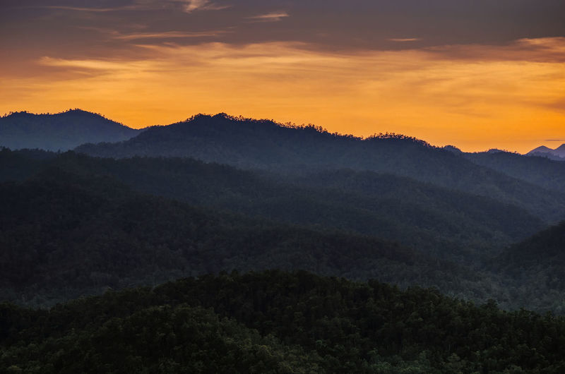 Deep mountain forest with twilight sunset sky. Mountain View Twilight Beauty In Nature darkness and light Deep Forrest Forest Jungle Landscape Mountain Mountain Range Mountains Nature Outdoors Scenics Sky Sunset Twilight Sky