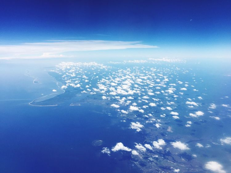 Blue Aerial View Sea Water Scenics Tranquil Scene Beauty In Nature Tranquility Ocean Idyllic Majestic Nature Cloud - Sky Coastline Sky Day Cloud Seascape Cloudscape Above