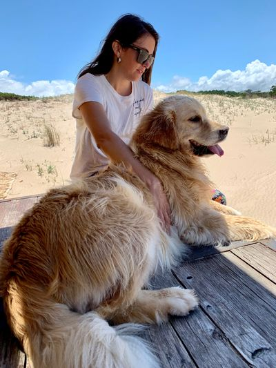 Woman with dog on table relaxing outdoors
