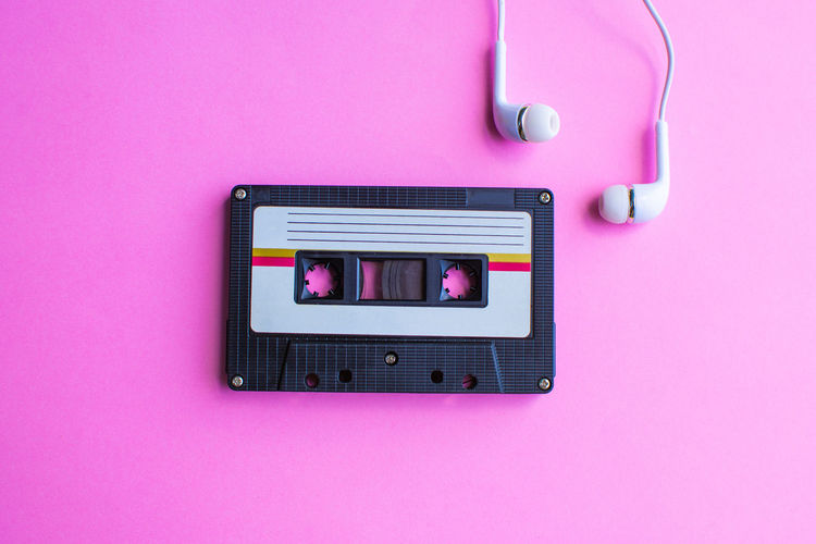 Tape Cassette Retro Old Technology Indoors  Connection Communication Close-up No People Single Object Directly Above Colored Background Studio Shot Electrical Equipment