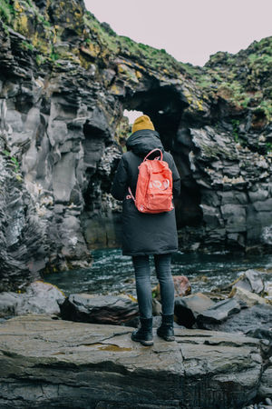 Adventure Backpack Beauty In Nature Casual Clothing Cliff Day Full Length Iceland Lifestyles Nature Nature Nature Photography Non-urban Scene Outdoors Outside Rock Rock - Object Rock Formation Standing Tourism Tourist Tranquility Vacations