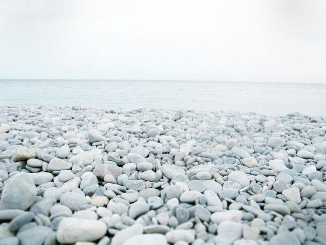 Nocolor White Sea Pebble Beach Pebble Beach Tranquil Scene Horizon Over Water Beauty In Nature Nature Scenics Tranquility Surface Level Outdoors Water No People Sunset Day Clear Sky Horizon Sky Nice, France France Rock Gray