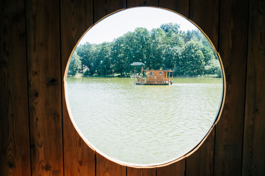 Hausboottour in Lindow / Brandenburg Friends The Great Outdoors - 2018 EyeEm Awards The Portraitist - 2018 EyeEm Awards The Traveler - 2018 EyeEm Awards Youth Architecture Boat Built Structure Circle Day Entrance Friendship Geometric Shape Hausboot Nature No People Outdoor Outdoors Plant Reflection Shape Sky Transparent Tree Water Window Wood - Material Young Adult Summer Road Tripping