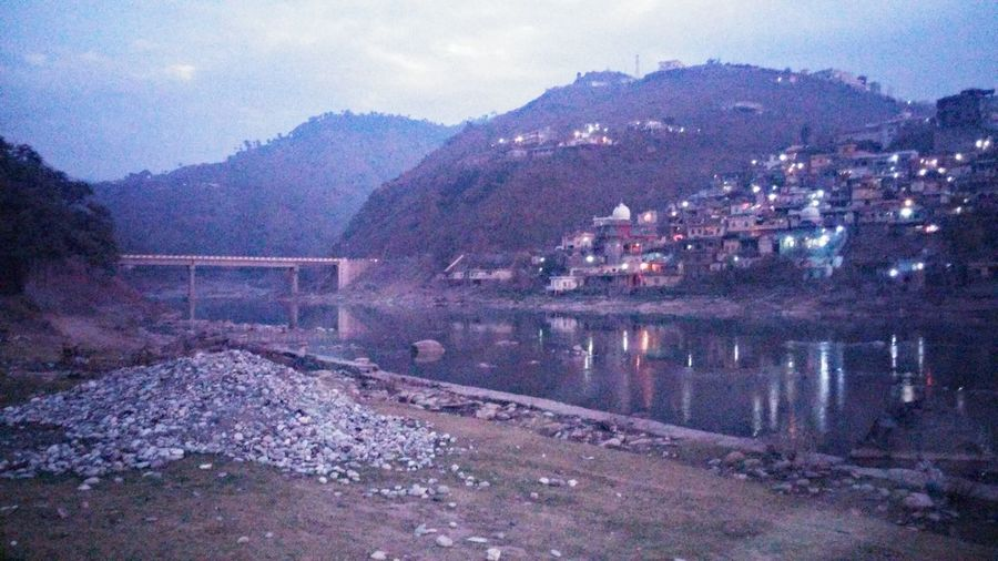 The KIOMI Collection Border At Night Bridge Over Neelam River Black Water At Night Lights On Darkness Two People And A Car