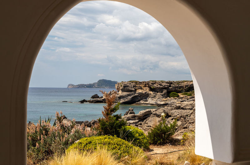 View out of an archway at the rocky coastline at kallithea therms, kallithea spring on rhodes island