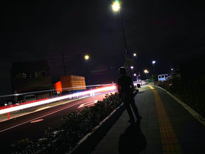 Rear view of light trails on street at night