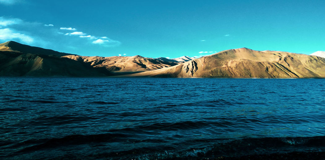 Pangong Lake ,world's highest saltwater lake, Ladakh 🌊🌊 Blue Water Blue Lake Landscape Wanderlust Adventure Sublime Landscapes Ladakh Leh EyeEm Selects Trip Cloud Cloud - Sky Clouds And Sky EyeEm Nature Lover EyeEm Best Shots EyeEmNewHere Nature Observation Point Serene Water Mountain Snow Winter Lake Blue Cold Temperature Glacier Wilderness Area View Into Land