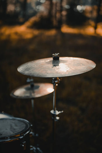 EyeEmNewHere Absence Arts Culture And Entertainment Close-up Cymbal Day Drum Drum - Percussion Instrument Drum Kit Focus On Foreground Metal Music Musical Equipment Musical Instrument Nature No People Percussion Instrument Selective Focus Table Wood - Material