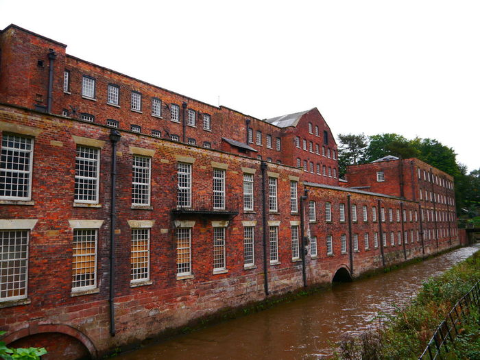Quarry Bank Mill Architecture Building Exterior Built Structure Sky Clear Sky Window Building Brick Nature No People Brick Wall Wall Day Water Canal Outdoors Residential District Old Waterfront