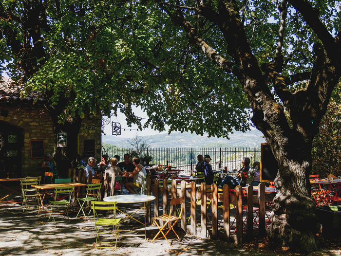Faucon Provence Provence Alpes Cote D´Azur Adult Architecture Chair Crowd Day Faucon  Group Of People Large Group Of People Leisure Activity Lifestyles Men Nature Outdoors Plant Real People Scenics Seat Shadow Sitting Summer Table Tree Women