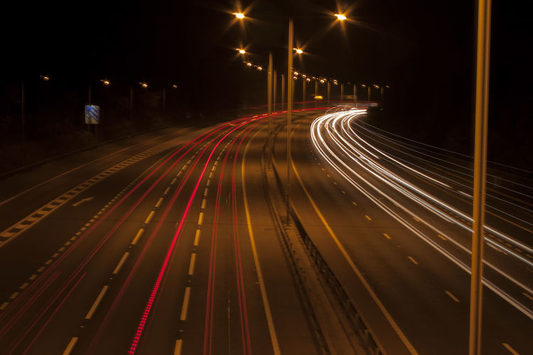 The Road Never Sleeps Light Speed Looking Down M25 Surrey Woking Fast Moving Cars High Angle View High Street Illuminated Light Trail Long Exposure Motion Night No People Outdoors Railroad Track Speed Transportation Mobility In Mega Cities Stories From The City Visual Creativity