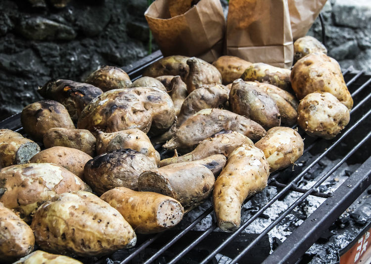 High angle view of grilled sweet potatoes on barbecue grill