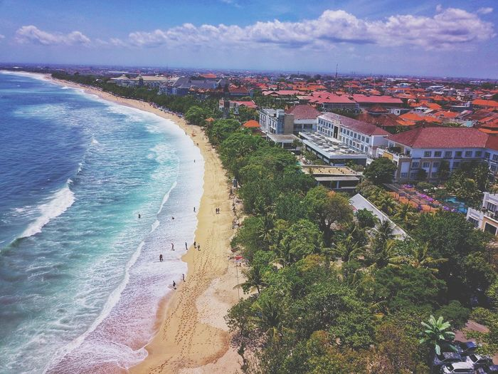 Kuta Bali Bali Kuta City Water Sea Beach Cityscape Sand Aerial View Stadium High Angle View Sky TOWNSCAPE Rooftop Town Townhouse Bell Tower Place Location Tiled Roof  Old Town Office Building Crowded Coastline Residential District Residential Structure Skyscraper