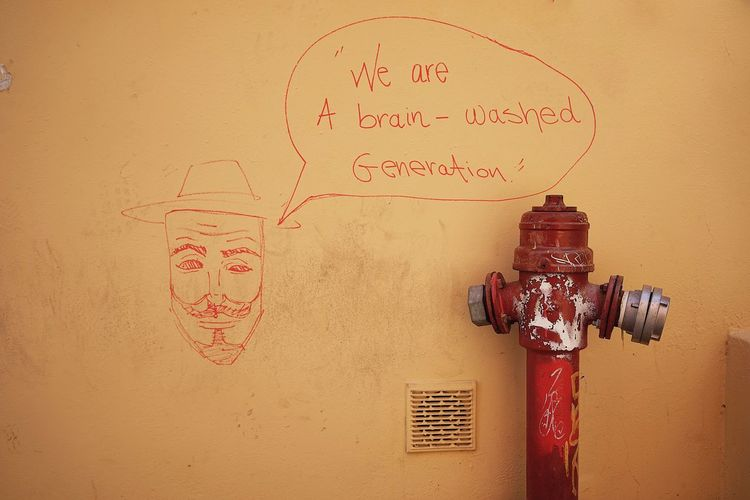 Chania Crete Fire Hydrant Wall - Building Feature No People Communication Text Art And Craft Creativity Indoors  Western Script Close-up Representation Drawing - Art Product Architecture Red Built Structure Human Representation Nature Graffiti Wall