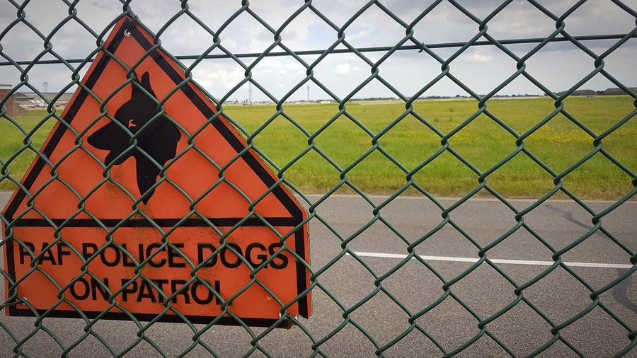 RAF Coningsby Police Dogs on Patrol Dog Sign Boundary Metal No People Day Grass Sign Communication Outdoors