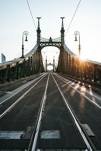 Budapest before life. Sunrise on Liberty bridge. 2018 Bridge Danube Duna Liberty Bridge Budapest Hungary Pele Photography Sunrise Sunrise_sunsets_aroundworld Sunrise_Collection Early Morning City Bridge - Man Made Structure Sky Travel vanishing point Empty Road Railroad Track Iron - Metal Rail Transportation Railroad Station Platform