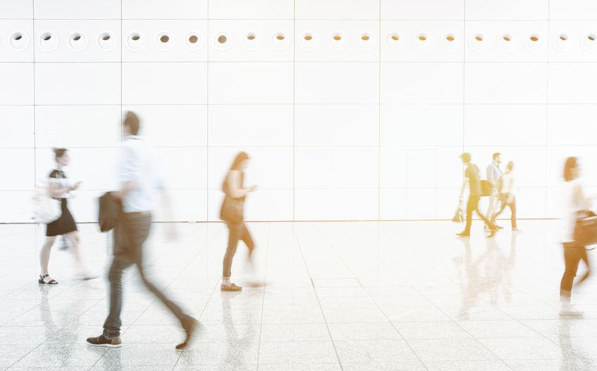 Blurred Image Of People Walking In Corridor