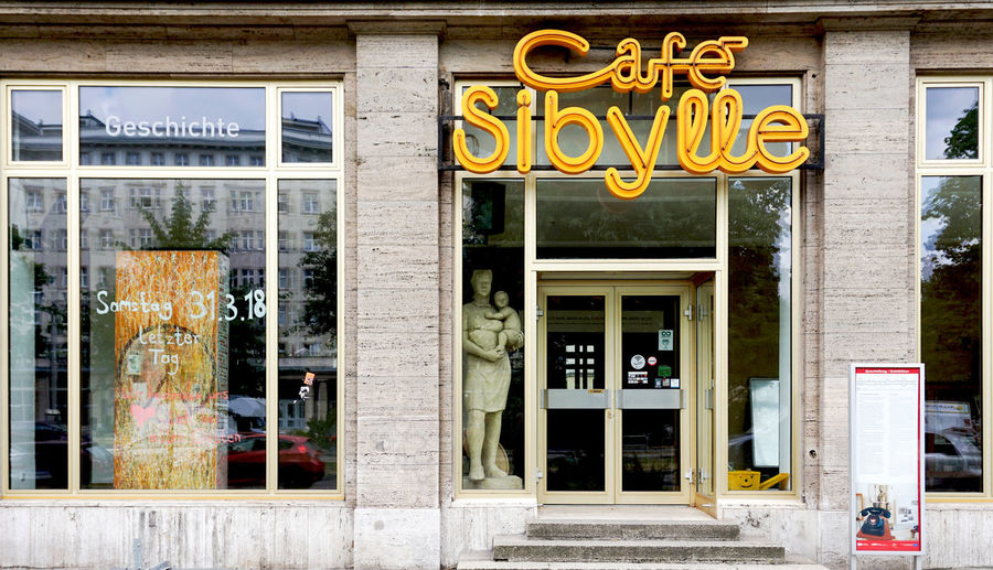 Café Sibylle, Berlin Building Exterior Text Built Structure Architecture Window Glass - Material Day Transparent Communication Western Script Entrance Business Door City No People Store Window Outdoors Retail Display Message Cafe Sibylle DDR GDR